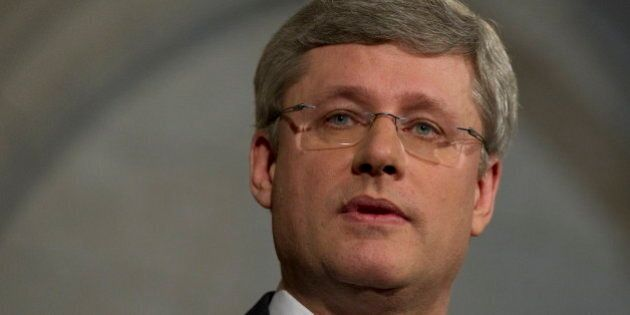 Prime Minister Stephen Harper speaks with the media outside the House of Commons on Parliament Hill in...