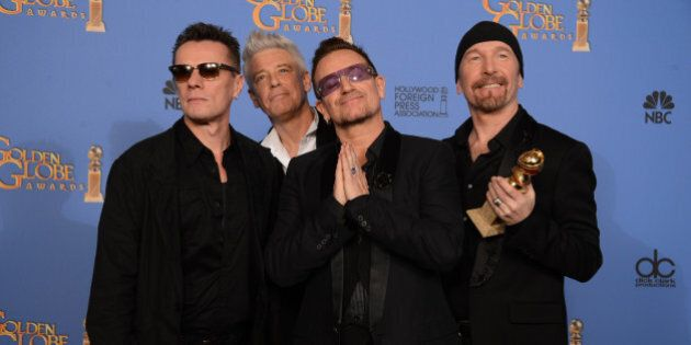From left, Larry Mullen Jr., Adam Clayton, Bono and The Edge of U2 pose in the press room with the award...