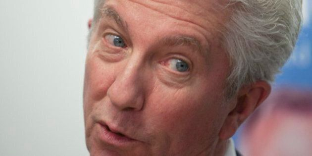 Bloc Quebecois Leader Gilles Duceppe responds to reporter's questions at a news conference at a local...