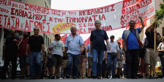 ATHENS, GREECE - JULY 11:  Anti-austerity demonstrators, from the communist party, take part in a minor rally through the streets of Athens on July 11, 2015 in Athens, Greece. Greek Prime Minister Alexis Tsipras has won the backing of parliament with the new debt proposal which has been given to Greece's creditors - the European Commission, the European Central Bank and the International Monetary Fund. European leaders will meet on Sunday to decide on the country's fate and whether it should stay in the euro.  (Photo by Christopher Furlong/Getty Images)