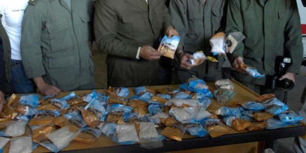 Lebanese customs officers display confiscated drugs of Captagon pills found in a bus, at Beirut Port,...