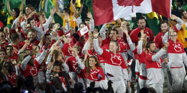 Canada's athletes wave as they take part during the opening ceremony of the 2015 Pan Am Games in Toronto,...