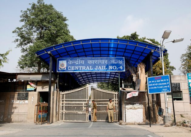 Police stand guard at one of the gates of the Tihar Jail, which is the biggest prison in South Asia,...
