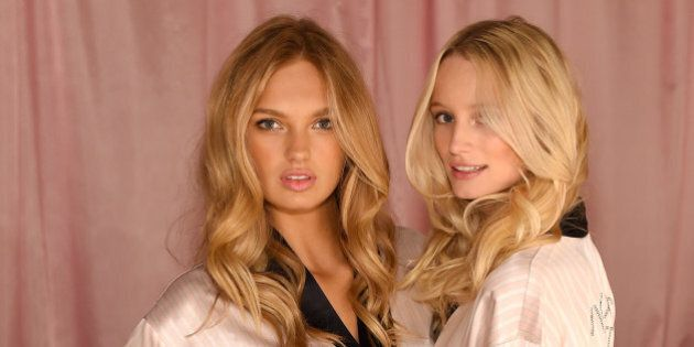 LONDON, ENGLAND - DECEMBER 02: Romee Strijd and Maud Welzen are seen backstage prior the 2014 Victoria's Secret Fashion Show on December 2, 2014 in London, England.  (Photo by Dimitrios Kambouris/Getty Images for Victoria's Secret)