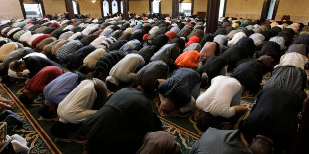 In this May 6, 2011 photo, Muslims pray at the Islamic Center of America in Dearborn, Mich. The killing...