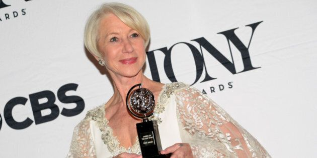Helen Mirren poses in the press room with the award for best performance by an actress in a leading role...