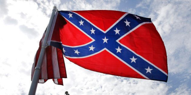 A protester waves a Confederate battle flag in front of the South Carolina statehouse, Thursday, July...