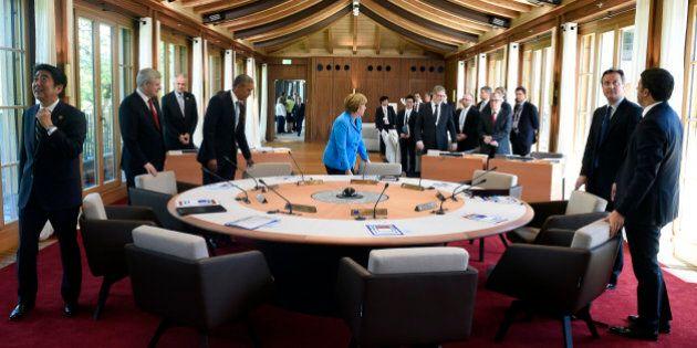 From left, Japanese Prime Minister Shinzo Abe, Canada's Prime Minister Stephen Harper, US President Barack...