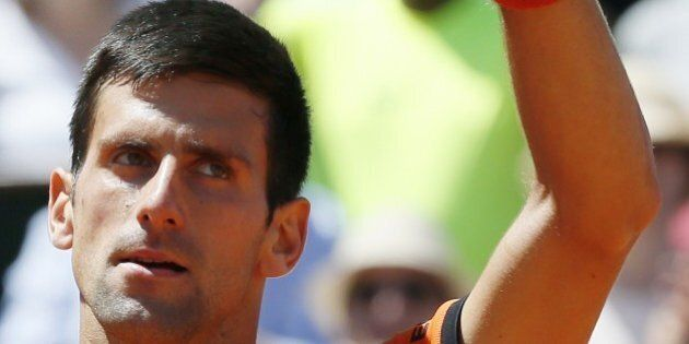 Serbia's Novak Djokovic celebrates his victory over Great Britain's Andy Murray during their men's semi-final...