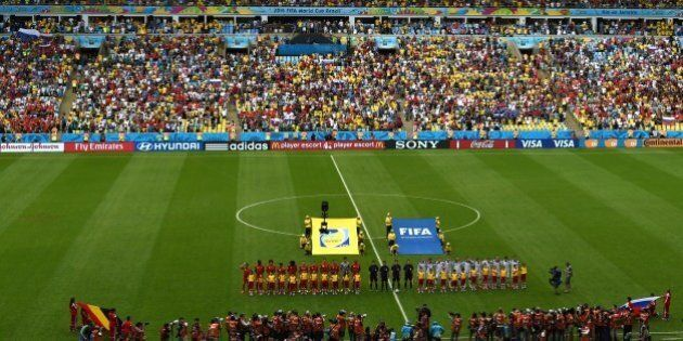 Footballers from Belgium and Russia pose before their Group H football match at the Maracana Stadium...