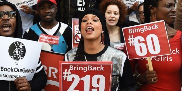 US singer-songwriter Alicia Keys (C) shouts slogans as she joins protesters with the 'Bring Back Our...
