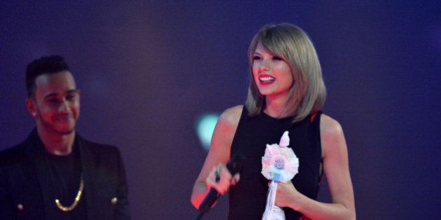 LONDON, ENGLAND - FEBRUARY 25: Taylor Swift accepting her International Solo Artist Award on stage at...