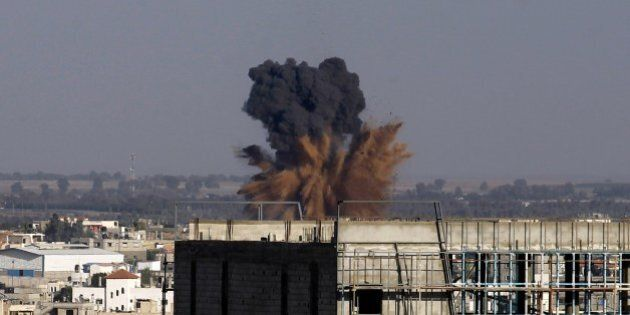 Smoke billowS following an Israeli air strike in Rafah in the southern of Gaza Strip, on August 19, 2014....