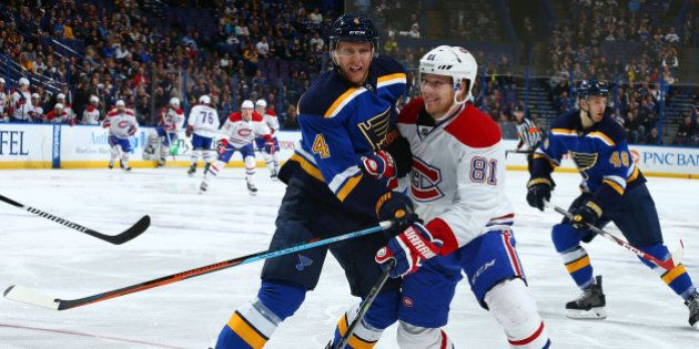 ST. LOUIS, MO - FEBRUARY 24: Carl Gunnarsson #4 of the St. Louis Blues looks to keep Lars Eller #81 of...