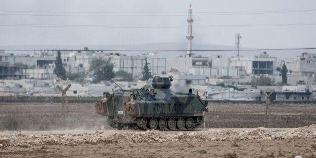 SURUC, SANLIURFA - OCTOBER 14: Military vehicles patrol along the Turkish-Syrian borderline in Suruc...