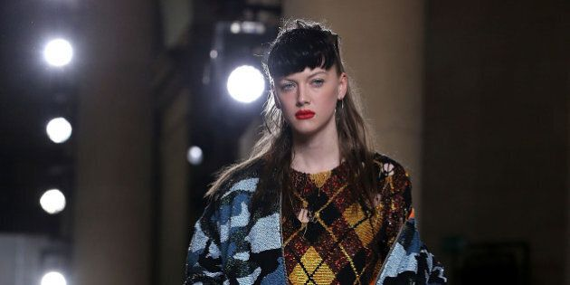 LONDON, ENGLAND - FEBRUARY 24: A model walks the runway at the Ashish show during London Fashion Week...