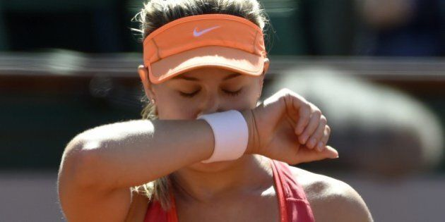 Canada's Eugenie Bouchard  reacts after a point during her French tennis Open semi-final match against Russia's Maria Sharapova at the Roland Garros stadium in Paris on June 5, 2014. AFP PHOTO / PASCAL GUYOT        (Photo credit should read PASCAL GUYOT/AFP/Getty Images)