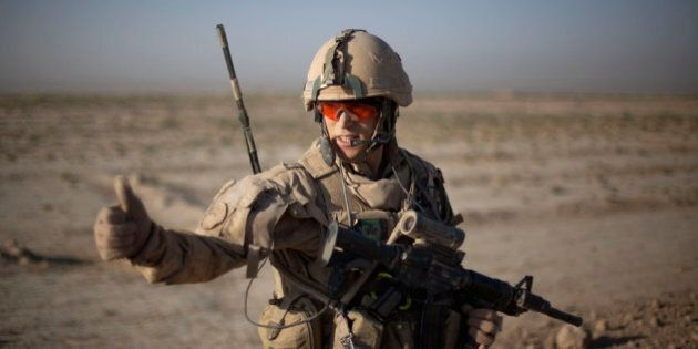 Pvt. Kevin Tessier, 20, of Montreal, Canada, with the Canadian Army's 1st Battalion Royal 22nd Regiment signals during an operation Wednesday, June 29, 2011 in the Panjwaii district of Kandahar province, Afghanistan. Canadian combat operations will end in July as troops withdraw from the southern region and hand control over to the Americans. Canada will transition to a non-combat training role with up to 950 soldiers and support staff to train Afghan soldiers and cops in areas of the north, west and Kabul. (AP Photo/David Goldman)