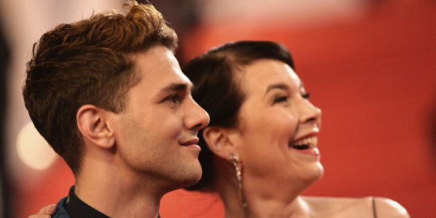 CANNES, FRANCE - MAY 22: Director Xavier Dolan and Anne Dorval attends the 'Mommy' premiere during the...