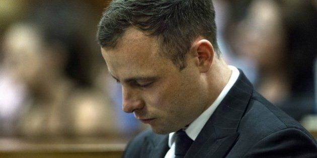 South African Paralympic athlete Oscar Pistorius looks down while his phycologist gives evidences during...