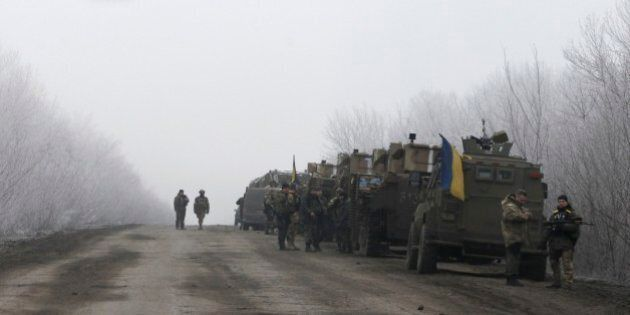Ukrainian military convoy stop on the road between the towns of Dabeltseve and Artemivsk, Ukraine, Saturday,...