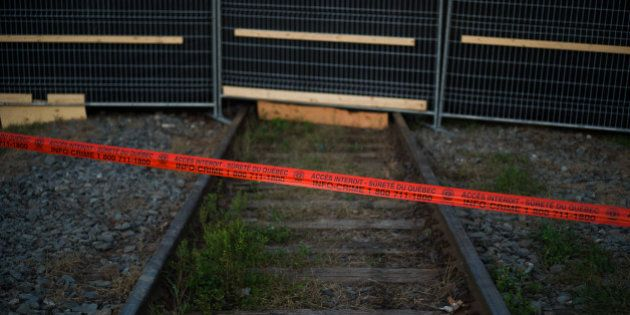 LAC-MEGANTIC, CANADA - JULY 14: Police tape marks the outside boundary of the 'red zone' crash site,...
