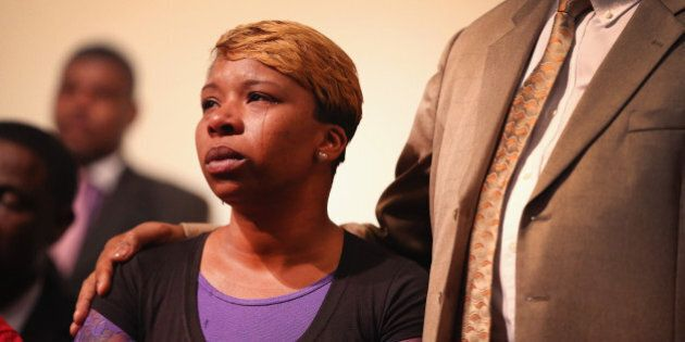 ST. LOUIS, MO - AUGUST 12: A tear rolls down the cheek of Lesley McSpadden, the mother of slain teenager...