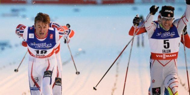 Norway's Petter Northug, left, crosses the finish line to win before second placed Alex Harvey of Canada,...