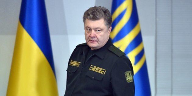 Ukrainian President Petro Poroshenko arrives for a live broadcast in Kiev to order the military to implement...