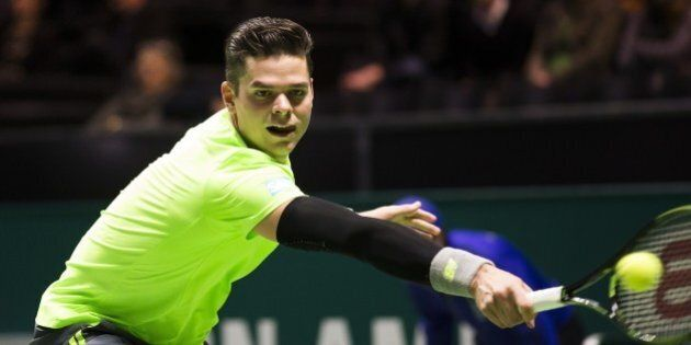 Canada's Milos Raonic returns the ball to Russia's Andrey Kuznetsov during their ABN AMRO World Tennis...