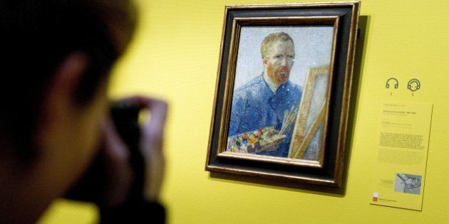 A visitor in the Van Gogh Museum Amsterdam takes a picture of the famous Dutch painter's self portrait...