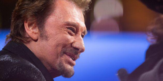 PARIS, FRANCE - DECEMBER 06: Singer Johnny Hallyday attends the 'France Television Telethon 2014' TV...