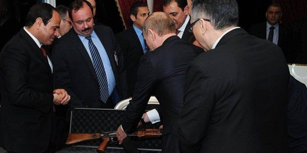 CAIRO, EGYPT - FEBRUARY 9: Russian President Vladimir Putin (2nd R) gives an AK47 rifle as a gift to...