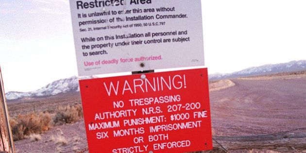 365994 03: A warning sign marks the boundary of Area 51, March 12, 2000 in Rachel, Nevada. This sleepy...