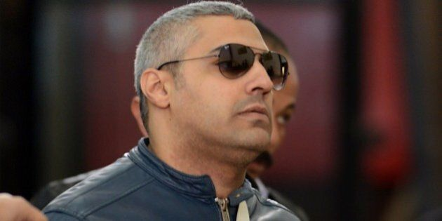 Al-Jazeera journalist Egyptian-Canadian Mohamed Fahmy arrives at the court in Cairo for his retrial on...
