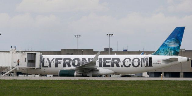 A worker enters the Frontier Airlines plane that Amber Vinson flew from Cleveland to Dallas on Monday,...