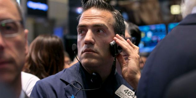 Trader Gregory Rowe works on the floor of the New York Stock Exchange, Thursday, Oct. 2, 2014. U.S. stocks...