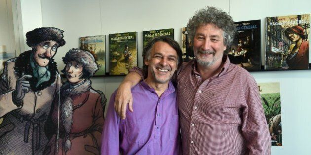 Comic Strip authors Jean-Louis Tripp (L) and Regis Loisel pose next to heroes of 'Magasin General' (General...
