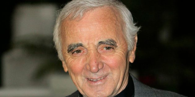 French singer Charles Aznavour poses for a photocall during the 43rd MIDEM (International record music...