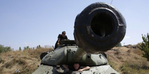 Servicemen are in the WWII Soviet tank IS-3 captured from pro-Russia militants at the position of the...