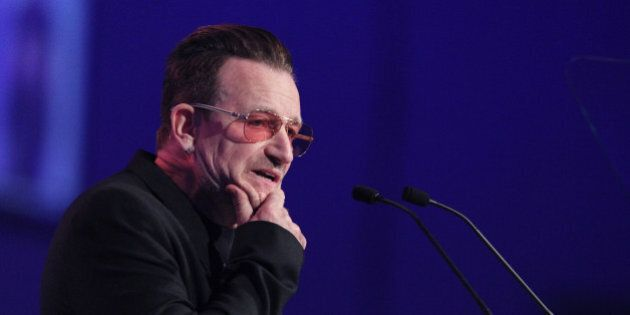 Irish singer and frontman of U2, Bono addresses delegates at the Dublin Convention Centre in Dublin,...