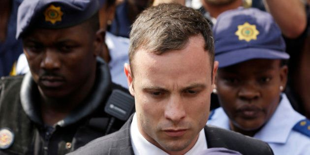 Oscar Pistorius leaves the high court in Pretoria, South Africa, Monday, Oct. 13, 2014. Pistorius faces...