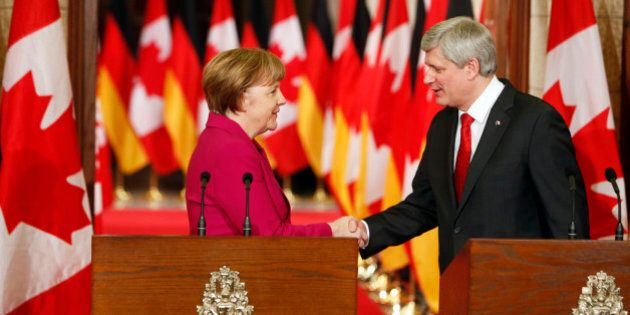 OTTAWA, CANADA -FEBRUARY 09: German Chancellor Angela Merkel (L) shakes hands with Canada's Prime Minister...