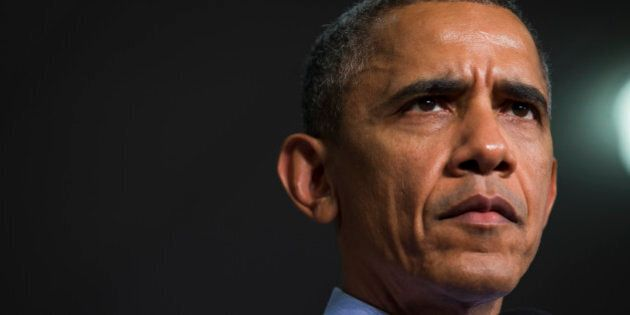 President Barack Obama listens to a question during an event at Ivy Tech Community College, Friday, Feb....