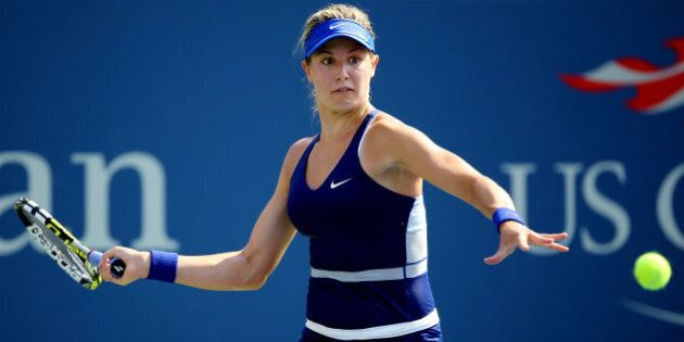 NEW YORK, NY - AUGUST 26:  Eugenie Bouchard of Canada returns a shot against Olga Govortsova of Belarus during their women's singles first round match on Day Two of the 2014 US Open at the USTA Billie Jean King National Tennis Center on August 26, 2014  in the Flushing neighborhood of the Queens borough of New York City.  (Photo by Al Bello/Getty Images)