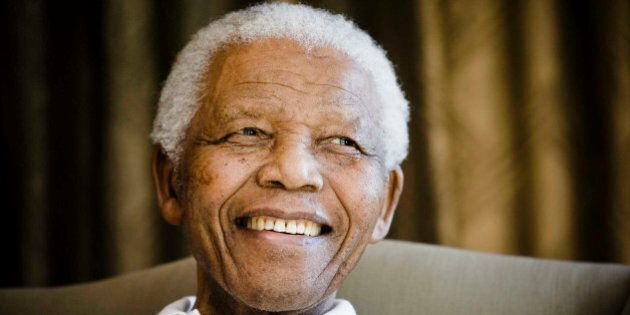 FILE - In this Tuesday, June 2, 2009 file photo, former South African President Nelson Mandela reacts...