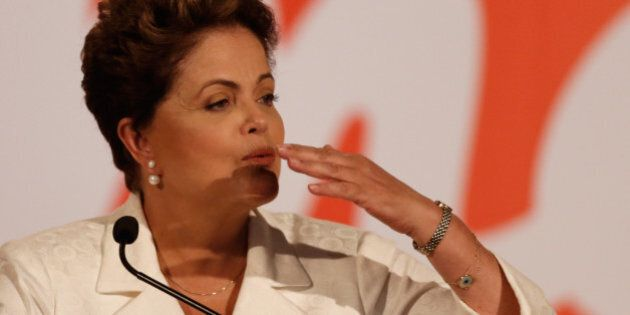 Brazil's President Dilma Rousseff, presidential candidate for re-election of the Workers Party,PT, blows...