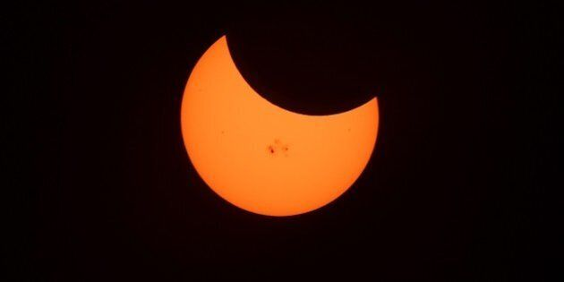 Sunspots are seen on the Sun as the Moon crosses during the peak moment at 3:27pm Pacific Time covering...