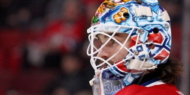 MONTREAL, QC - MAY 17: Peter Budaj #30 of the Montreal Canadiens looks on from in goal while taking on...
