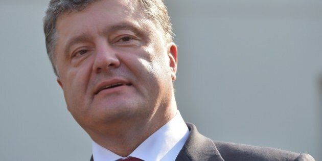 Ukraine's President Petro Poroshenko speaks to reporters outside of the West Wing following an Oval Office...